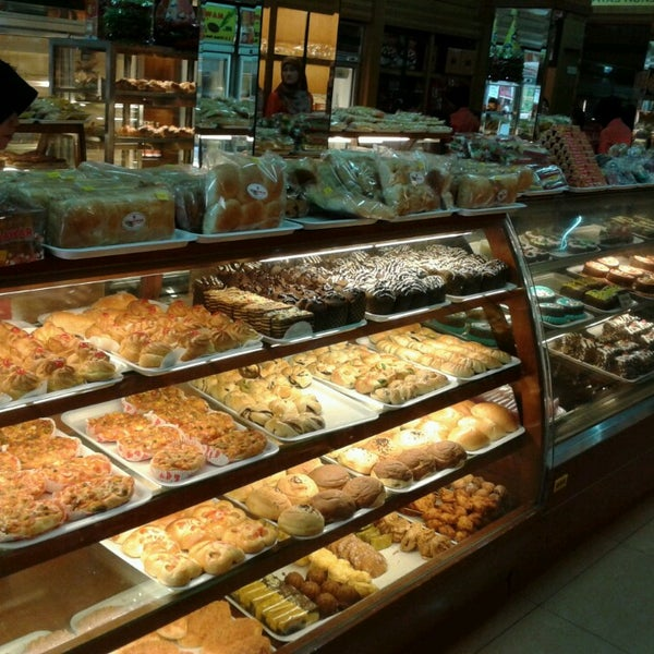 Photo taken at Mawar Bakery and Cake Shop by Iqbal H. on 3/24/2013