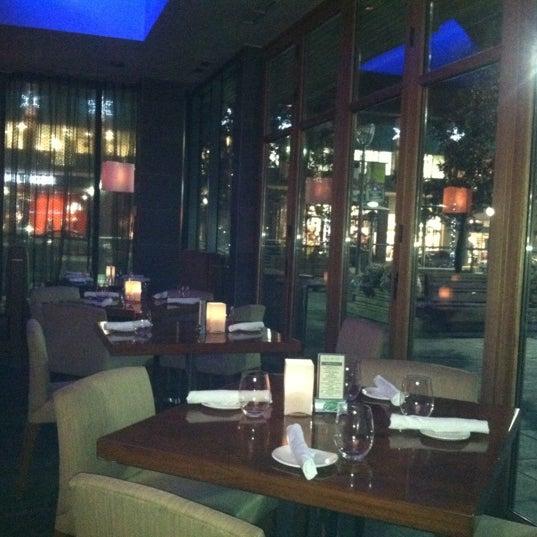 Photo taken at Glow Restaurant by Kathleen V. on 11/16/2012