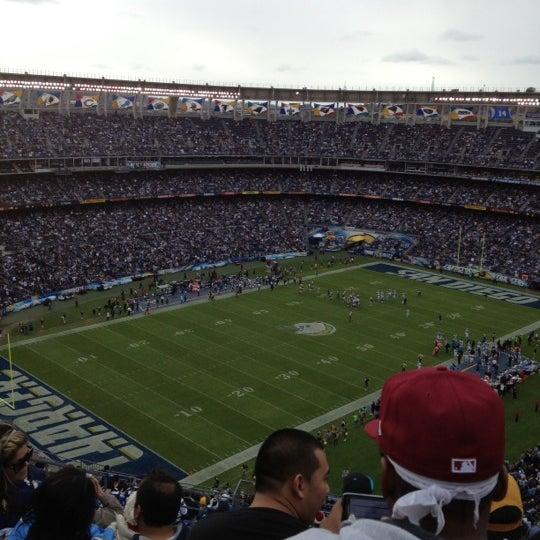 Photo taken at Qualcomm Stadium by Cassie D. on 12/16/2012