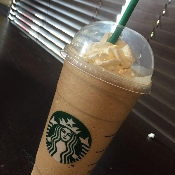 Photo taken at Starbucks by Fernanda M. on 4/4/2015