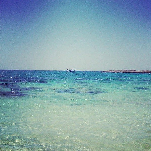 Photo taken at Makronissos Beach by Ася Р. on 6/3/2013