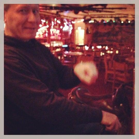 Photo taken at Million Dollar Cowboy Bar by Sarah C. on 12/24/2012