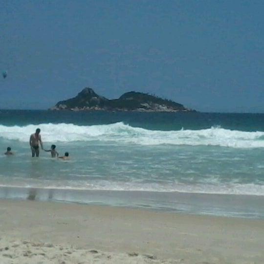 Photo taken at Praia da Barra da Tijuca by Daiane S. on 12/24/2012
