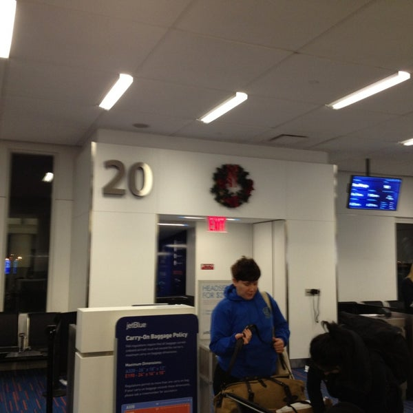 Photo taken at Gate 20 by Marshall M. on 1/2/2013