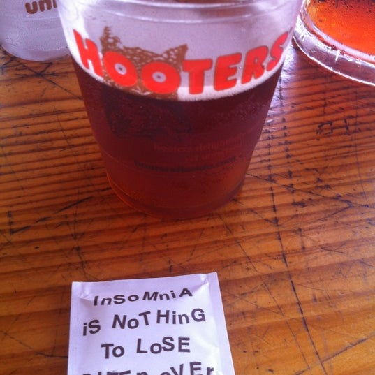 Photo taken at Hooters by Christina W. on 12/26/2012