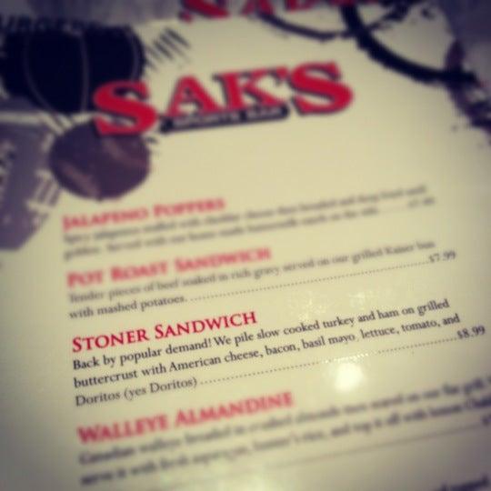 Photo taken at Sak's Sports Bar by Kyle T. on 1/11/2012
