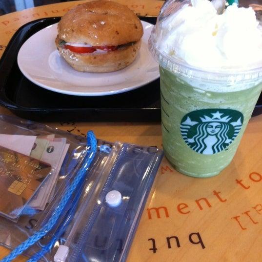 Photo taken at Starbucks by ・㉨・ on 4/13/2012