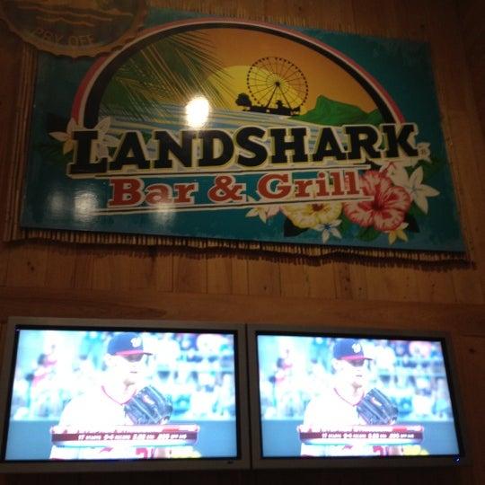 Photo taken at Landshark Bar & Grill by Greg B. on 7/11/2012