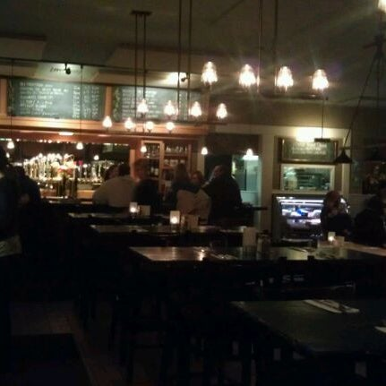 Photo taken at The Farmhouse Tap & Grill by Mac G. on 2/16/2012