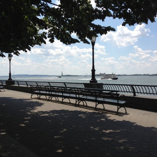 Photo taken at Battery Park City Esplanade by Katie L. on 7/2/2012