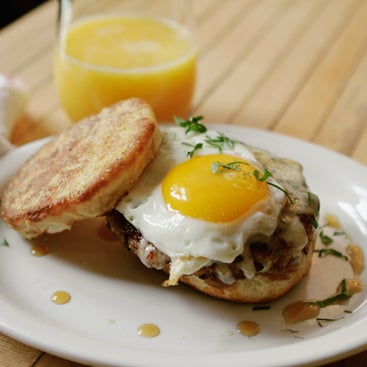 Try one of the newest additions to Mile End's menu, the breakfast burger, involves a juicy veal and turkey sausage patty, cheddar and apple-maple butter sandwiched by a house-made English muffin.