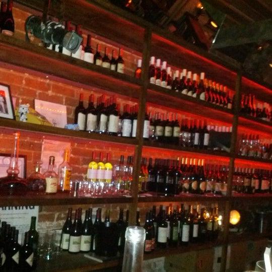Photo taken at Custom Wine Bar by F L. on 8/18/2012