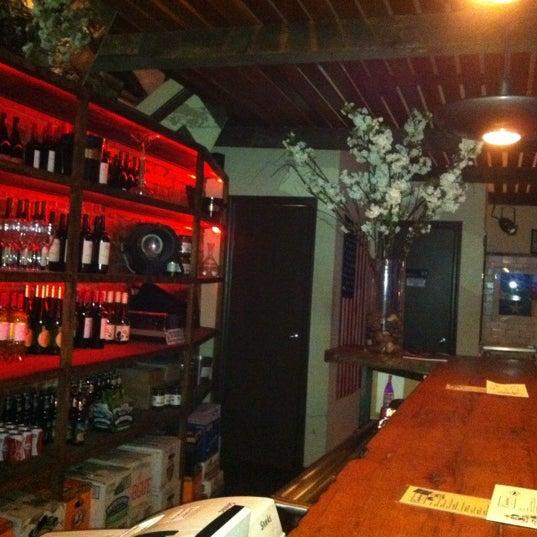Photo taken at Custom Wine Bar by Sebastian G. on 3/3/2012