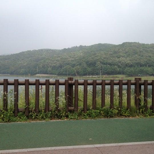 Photo taken at Yuldong Park by Bernard O. on 7/4/2012