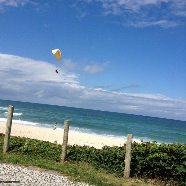 Photo taken at Praia da Barra da Tijuca by Amanda G. on 4/21/2013