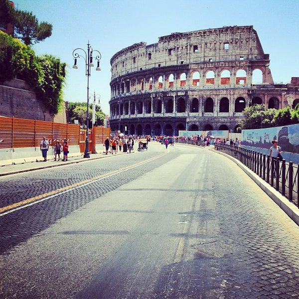 Photo taken at Piazza del Colosseo by Igor M. on 6/30/2013