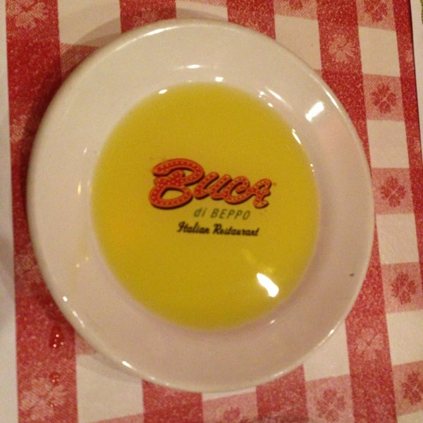 Photo taken at Buca di Beppo by Ilenia M. on 5/21/2013