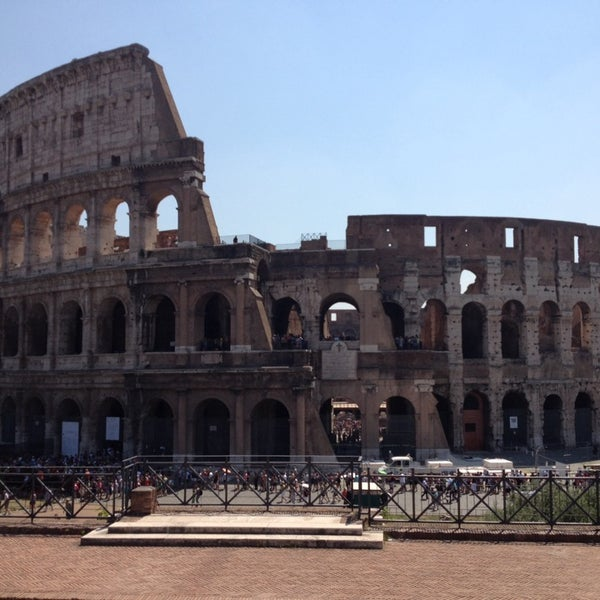 Photo taken at Piazza del Colosseo by Richard Y. on 7/25/2013