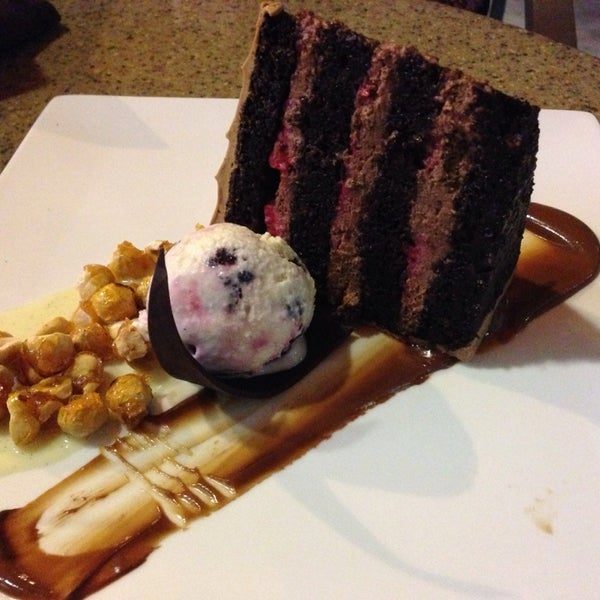 Photo taken at Crave Dessert Bar & Lounge by Chris A. on 7/12/2014