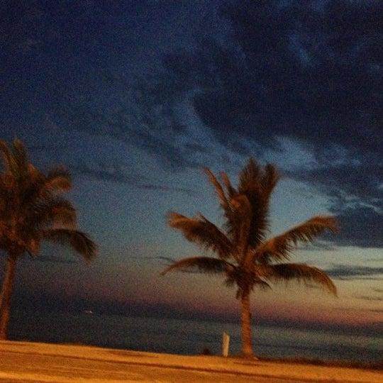 Photo taken at Praia da Barra da Tijuca by Rejane Z. on 12/8/2012