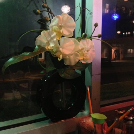 Photo taken at Sushi Cafe by Elena P. on 11/4/2012