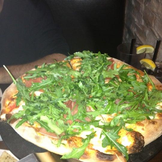 Photo taken at Tartini Pizzeria & Spaghetteria by Tamara L. on 3/4/2013