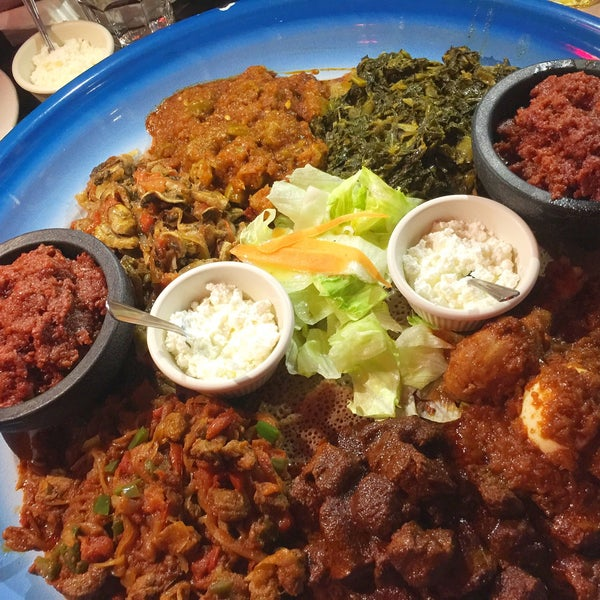 Photo taken at New Eritrea Restaurant & Bar by Annie . on 4/4/2017
