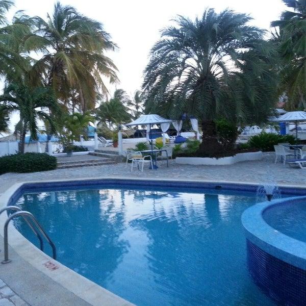Photo taken at Playa El Yaque by Rolando J. A. on 7/8/2013