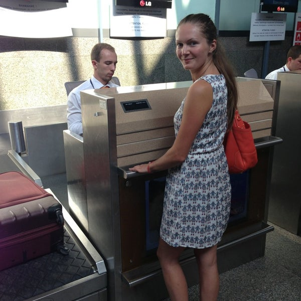 Photo taken at Check-in desk by George N. on 7/3/2013