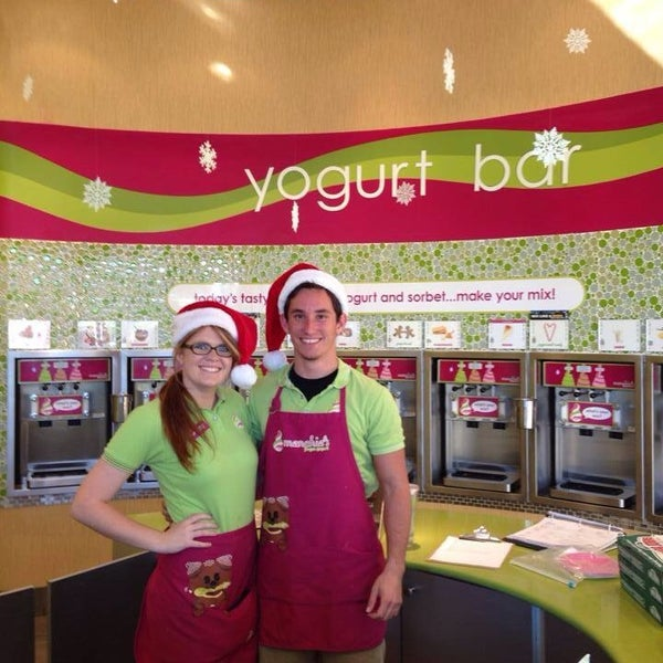 Photo taken at Menchie's Red Bug Village by Myriam S. on 12/15/2013