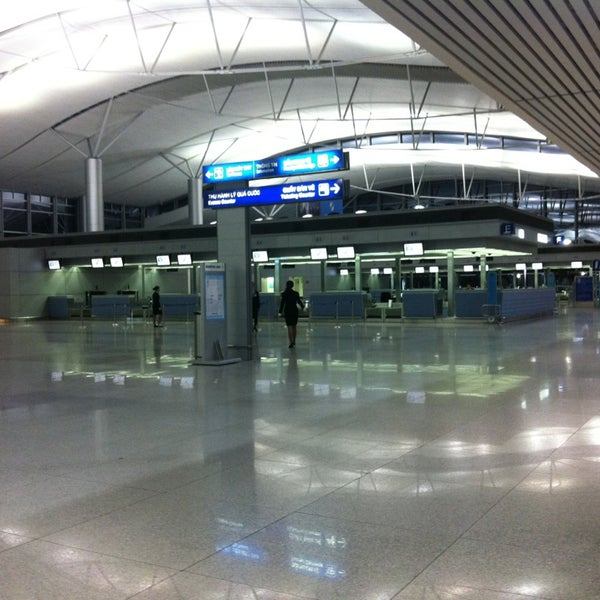 Photo taken at Tan Son Nhat International Airport (SGN) by Chu T. on 3/18/2013