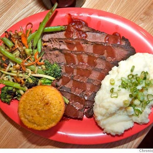 Several styles of regional barbecue star at this Richmond spot. Try the texas brisket or the slow-smoked ribs with one of the restaurant's five barbecue sauces.