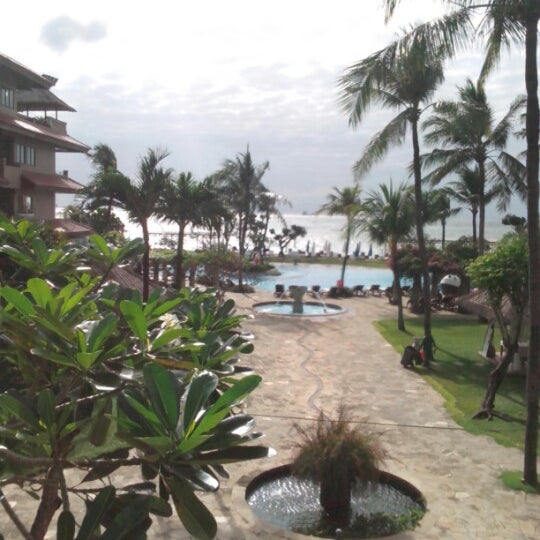 Photo taken at Grand Aston Bali Beach Resort by Esther I. on 8/6/2013