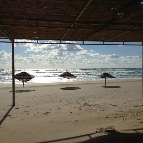 Photo taken at Ramo Beach by Taus N. on 1/19/2013