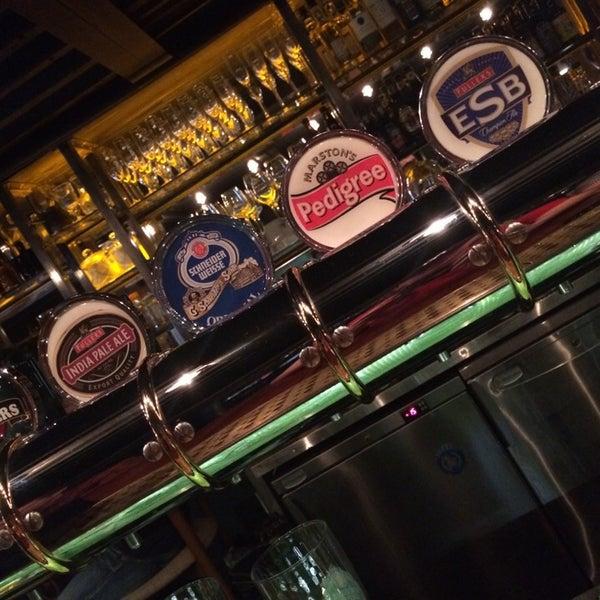Photo taken at Haggis Pub & Kitchen by Александр М. on 8/27/2014