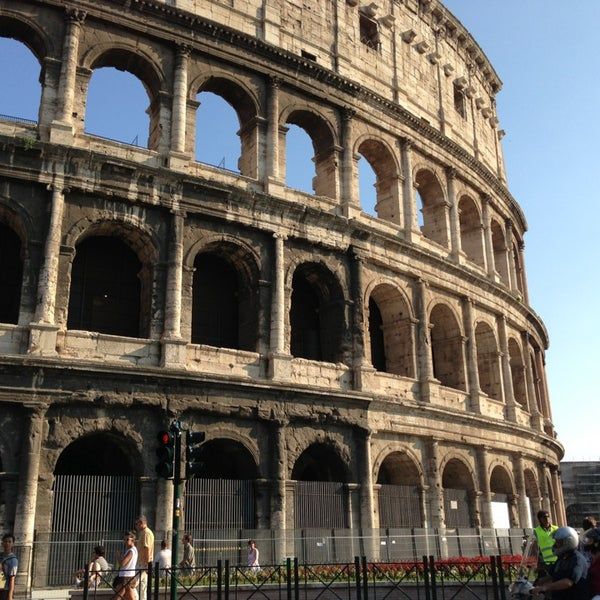 Photo taken at Piazza del Colosseo by Ruslan i. on 7/24/2013