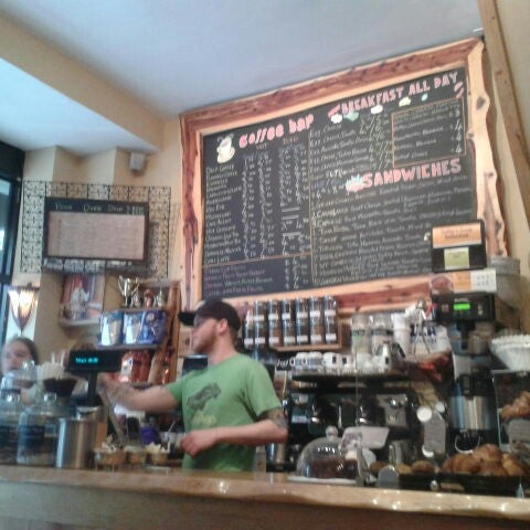 Photo taken at Pause Cafe by Alyson B. on 5/22/2013