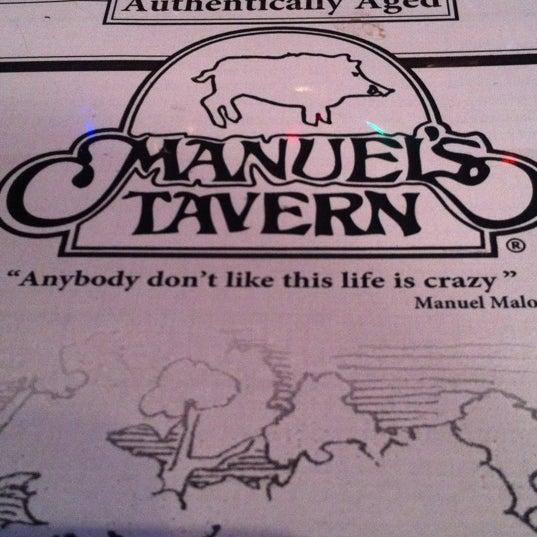 Photo taken at Manuel's Tavern by Robert J. on 12/13/2012