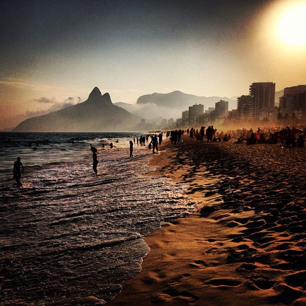 Photo taken at Ipanema Beach by Dimitri P. on 5/5/2013