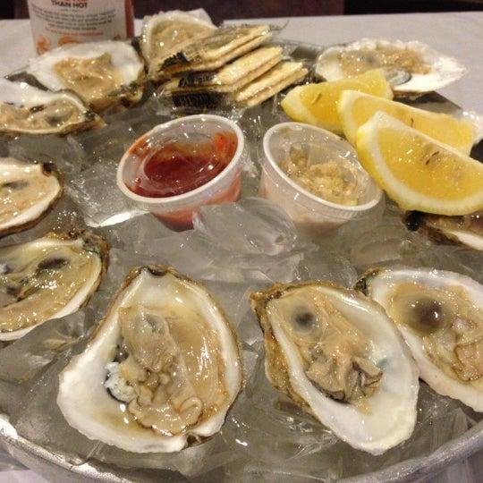 Photo taken at Hot N Juicy Crawfish by Cathy N. on 11/22/2012