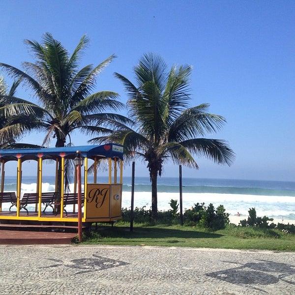 Photo taken at Praia da Barra da Tijuca by Tielli F. on 3/7/2013
