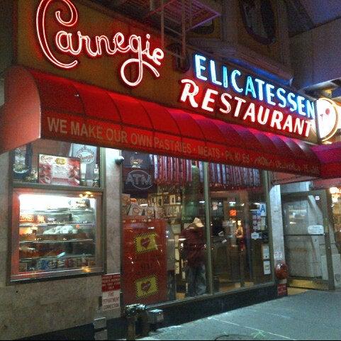 Photo taken at Carnegie Deli by Grant L. on 11/7/2012