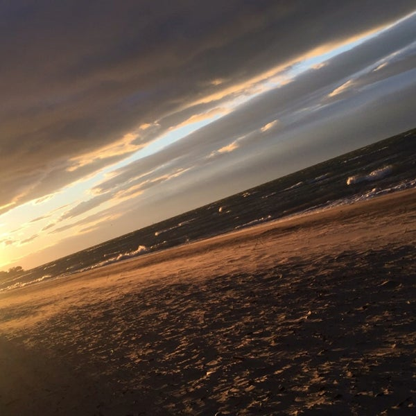 Photo taken at Durand Eastman Beach by Allecia N. on 6/13/2016