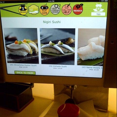 Photo taken at Sakae Sushi by Yayang D. on 7/14/2013