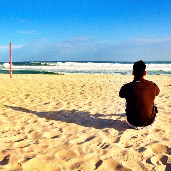 Photo taken at Praia da Barra da Tijuca by Douglas E. on 8/17/2014