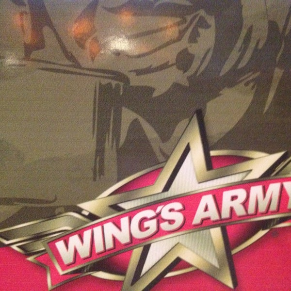 Photo taken at Wings Army by Mariana P. on 3/9/2013