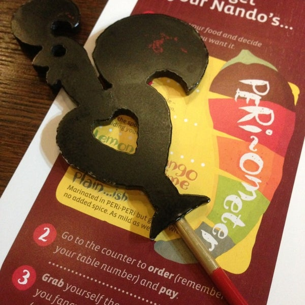 Photo taken at Nando's by Laura J. on 6/1/2013