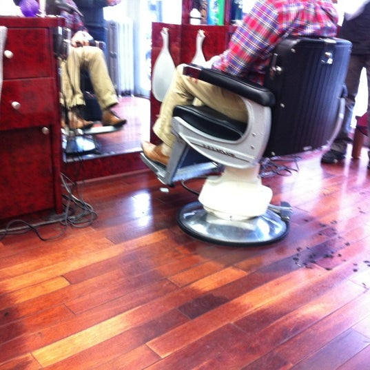 Photo taken at Manhattan Barber Shop by Max B. on 11/19/2012