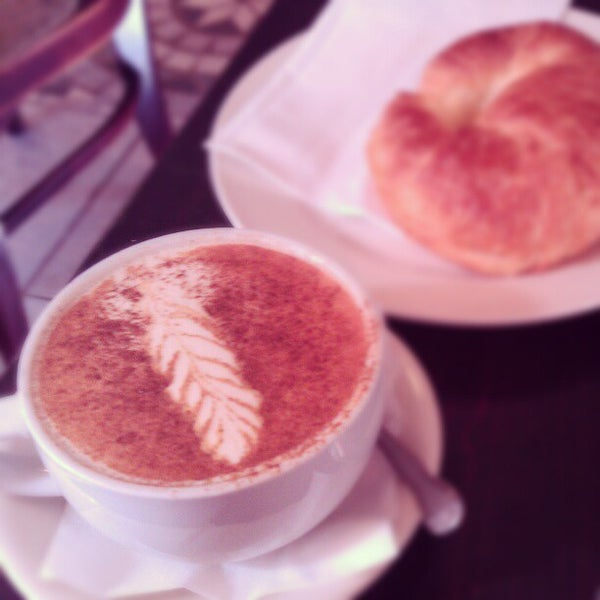 Photo taken at Tazza D'Oro Cafe & Espresso Bar by Kelly C. on 10/21/2012