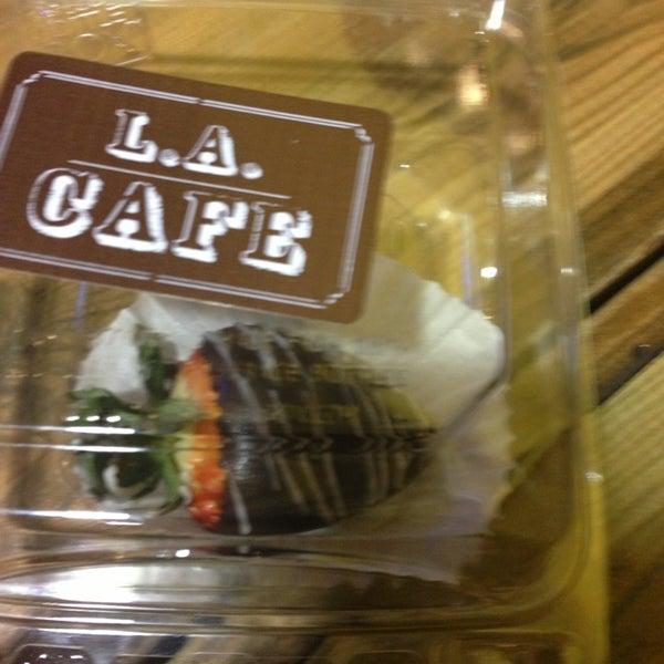 Photo taken at LA Café by Kholei M. on 1/28/2013